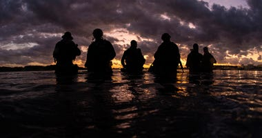 Members assigned to Naval Special Warfare Group 2 conduct military dive operations off the East Coast of the United States.