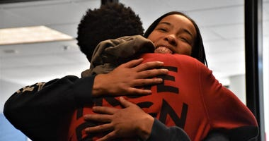 Marva Burns smiles, as she hugs her son Marquis Butts