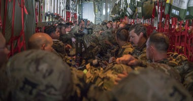 U.S. Army Soldiers, assigned to the East Africa Response Force (EARF), 101st Airborne Division, sit aboard a C-130J Super Hercules, assigned to the 75th Expeditionary Airlift Squadron, waiting to takeoff at Camp Lemonnier, Djibouti