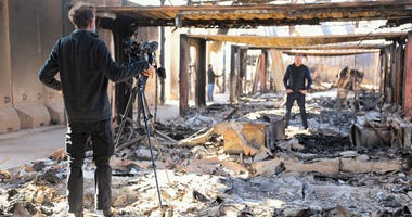 News agencies conduct field reporting in destroyed living quarters after the recent missile attacks at Al Asad Air Base, Iraq, Jan. 13, 2020