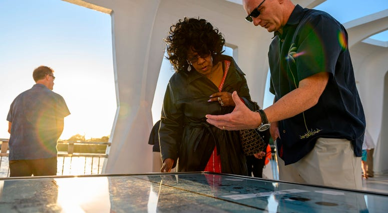 "Acting Secretary of the Navy Thomas B. Modly tours the USS Arizona Memorial with Brenda Haven, niece of World War II hero Doris ""Dorie"" Miller"