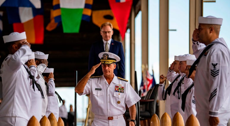 Adm. John C. Aquilino, Commander, U.S. Pacific Fleet, and Acting Secretary of the Navy Thomas B. Modly, depart the stage