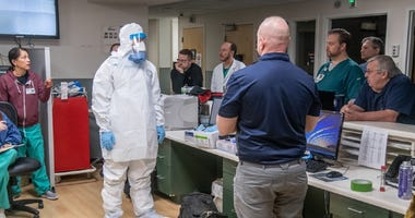 Members of the West Virginia National Guard train hospital staff prepare the hospital for possible future cases of COVID-19/SARS-CoV-2.