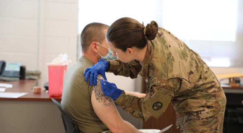 Army National Guard Troop Administering Vaccine