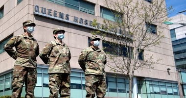 U.S. Army medical corps officers pose for a photo outside of Queens Hospital Center