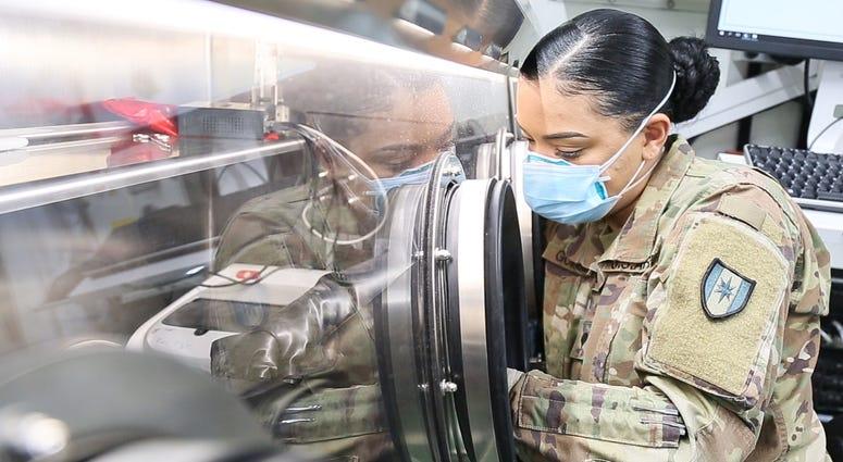 U.S. Army Spc. Crystal Gonzales conducts COVID-19 testing