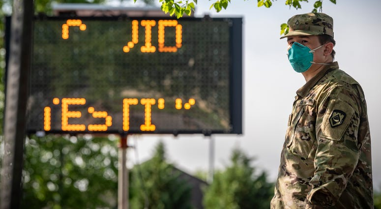 A West Virginia National Guard Soldier waits for local citizens to arrive to be tested for COVID-19