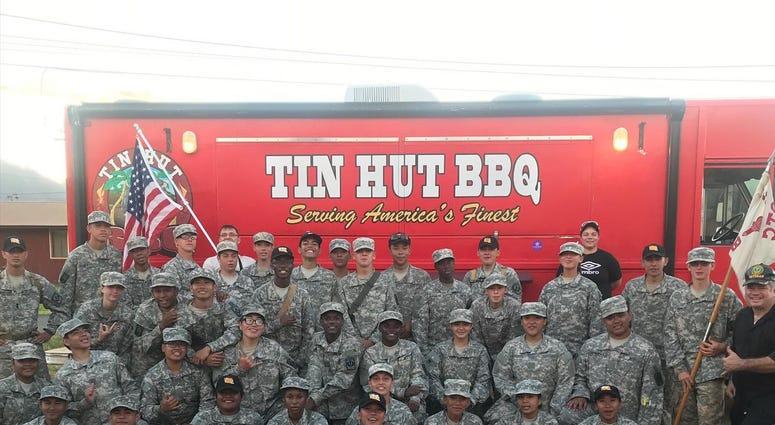 Navy Veteran owner of Tin Hut barbeque helps vets