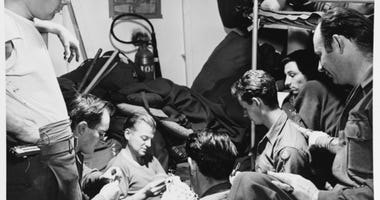 Army troops playing cards in their quarters aboard USS BOISE (CL-47) as she was returning them from Europe circa November 1945.