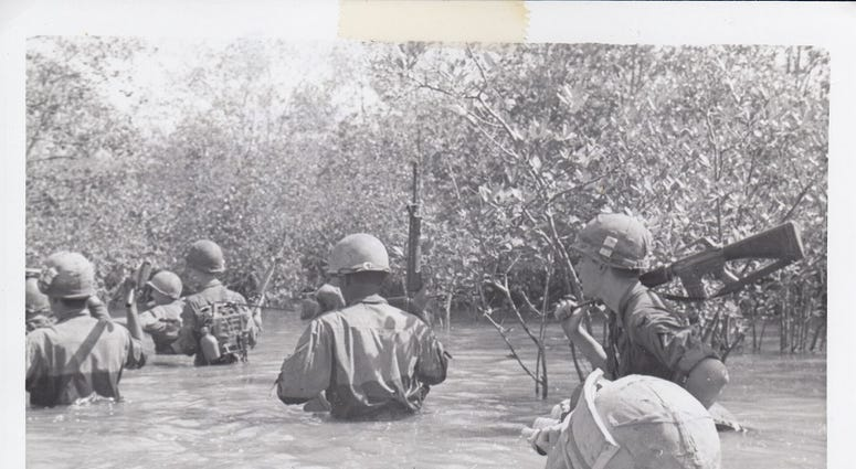 9th Infantry Signal Corps crossing a river