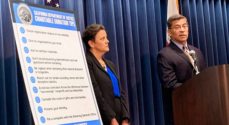 California Attorney General Xavier Becerra, right, and senior Assistant Attorney Genera Tania Ibanez announce a lawsuit the state has filed alleging misdeeds by Move America Forward
