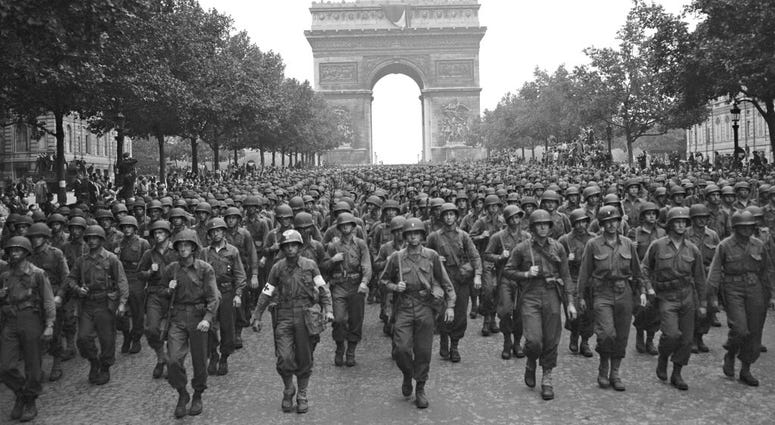 In this Aug. 29, 1944 file photo, U.S. soldiers of Pennsylvania's 28th Infantry Division march along the Champs Elysees