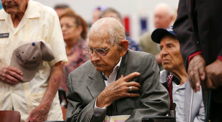 Cyrus Hayford Avey, Jr, 100, U.S. Air Force World War II veteran honors the flag during a ceremony at Joint Base San Antonio-Fort Sam Houston