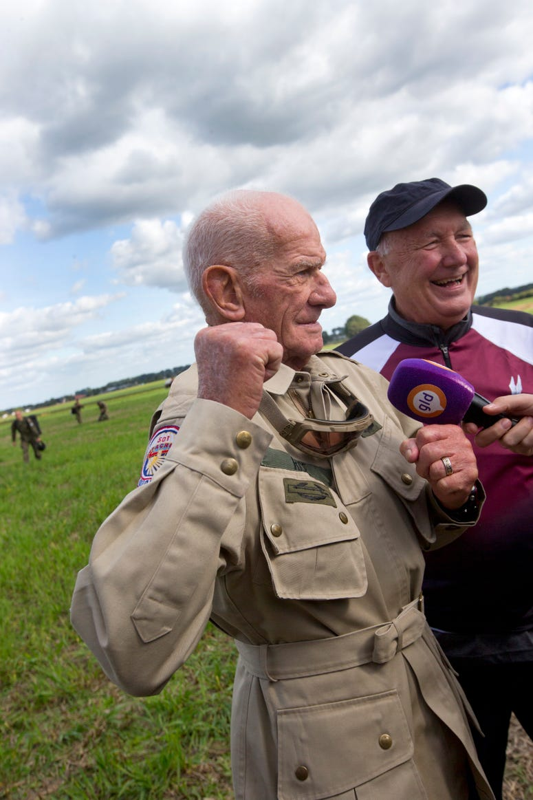 98 year old veteran talks to reporters after jumping out of plane to commemorate DDay.