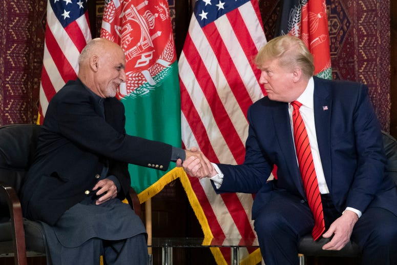 President Donald Trump shakes hands during a meeting with Afghan President Ashraf Ghani during a surprise Thanksgiving Day visit.