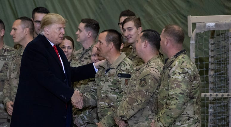 President Donald Trump greeting members of the military after speaking to members of the military during a surprise Thanksgiving Day visit.