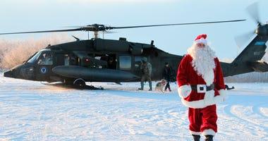 This Dec. 3, 2019 photo shows Santa Claus arriving in Napakiak, Alaska, on an Alaska National Guard UH-60 Black Hawk helicopter.