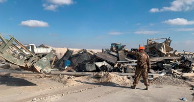 U.S. soldiers clear rubble from a site of Iranian bombing at Ain al-Asad air base in Anbar, Iraq