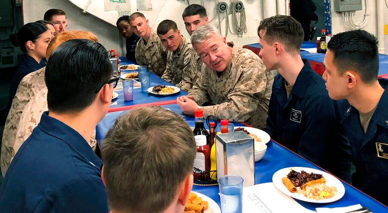 Marine Gen. Frank McKenzie, the top U.S. commander for the Middle East, meets with sailors and Marines on the USS Bataan amphibious assault ship on Thursday, Jan. 23, 2020