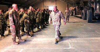 Marine Gen. Frank McKenzie, the top U.S. commander for the Middle East, meets with troops at Prince Sultan Air Base in Saudi Arabia