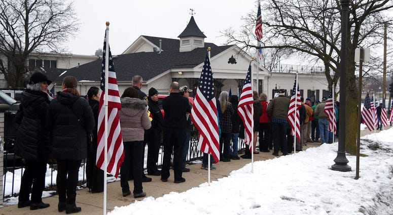 "When John James Murphy died in Elgin last month, he was an ""unclaimed veteran"" whose relatives couldn't be found or contacted to take care of his burial. Hundreds of people from Elgin and as far as Chicago, Aurora and Naperville attended"