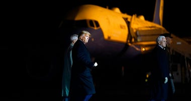 President Donald Trump and Vice President Mike Pence depart after watching a casualty return for Sgt. 1st Class Javier Gutierrez, of San Antonio, Texas and Sgt. 1st Class Antonio Rodriguez
