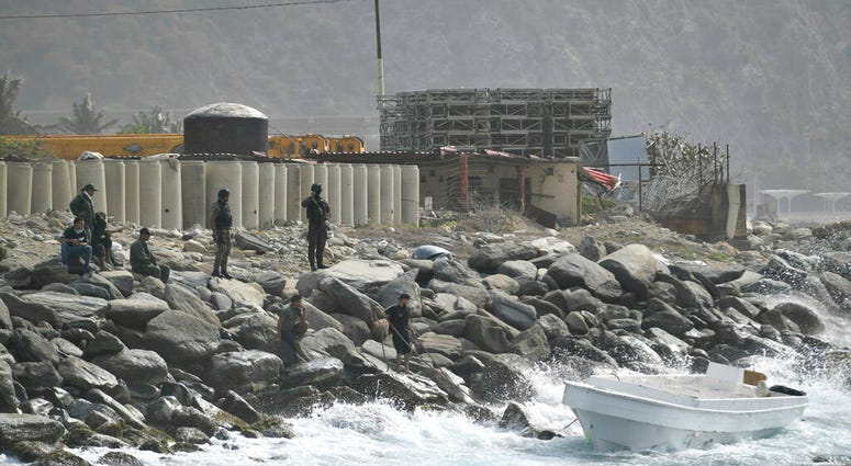 Security forces guard the shore area