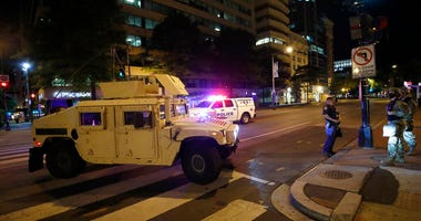 A military Humvee blocks an intersection along K Street in downtown Washington