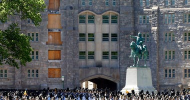 In this May 22, 2019 file photo, members of the senior class march past a statue of George Washington during Parade Day at the U.S. Military Academy in West Point, N.Y.