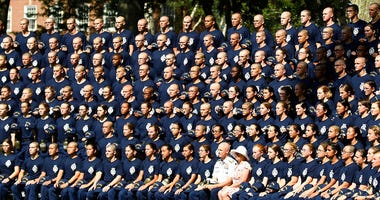In a Monday, July 1, 2019 file photo, U.S. Coast Guard Academy Superintendent Rear Adm. William G. Kelly and his wife Angie pose with the Class of 2023