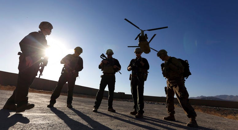 American soldiers wait on the tarmac in Logar province, Afghanistan, 2017