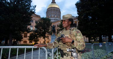 A member of the Georgia National Guard stands outside the State Capitol on Tuesday, July 7, 2020, in Atlanta