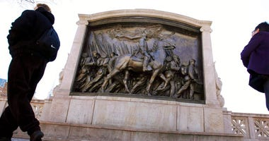 In this March 26, 2011, file photo, people walk past the memorial to Union Col. Robert Gould Shaw and the 54th Massachusetts Volunteer Infantry Regiment