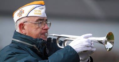 Jim Reynolds with Fox Lake VFW Post 9655 plays the bugle at the Veterans Day ceremony