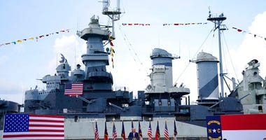 With the Battleship North Carolina in the background, President Donald Trump speaks during an event to designate Wilmington as the first American World War II Heritage City, Wednesday, Sept. 2, 2020