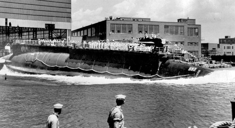 In this July 9, 1960, file photo, the U.S. Navy nuclear powered attack submarine USS Thresher is launched bow-first at the Portsmouth Navy Yard in Kittery, Maine.