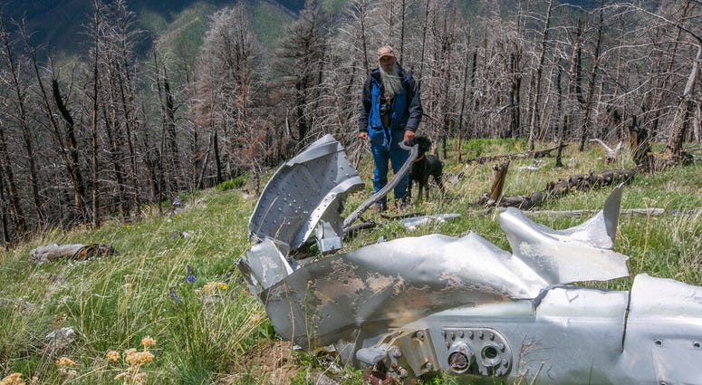 This June 2016, file photo shows wreckage from a U.S. Air Force that bomber crashed on Emigrant Peak