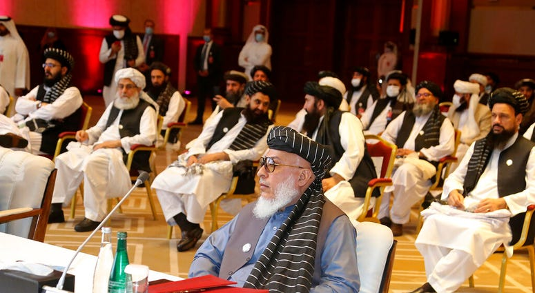 In this Sept. 12, 2020, file photo, Taliban negotiator Abbas Stanikzai, center front, and his delegation attend the opening session of peace talks between the Afghan government and the Taliban