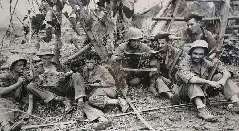 This Aug. 2, 1944 photo, courtesy of the U.S. Army Signal Corps, shows members of the famed WWII Army unit Merrill's Marauders less than 75 yards from enemy positions