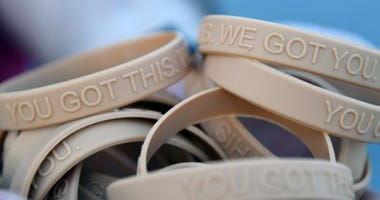 "Bracelets, labeled with the message, ""You Got This. We Got You,"" are handed out to participants during the Dragon March on Keesler Air Force Base, Mississippi, Sept. 13, 2019. The three-mile walk was held as part of the wing stand down day directed by Air"