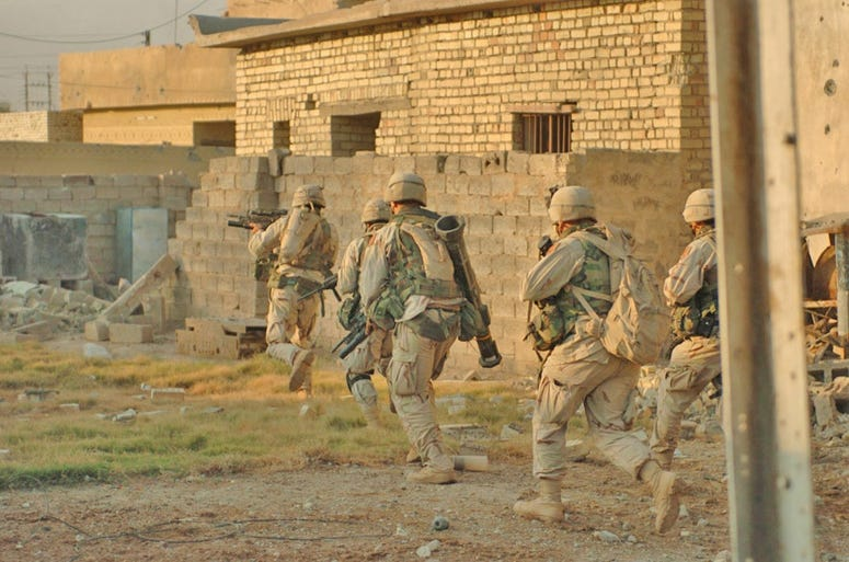 Soldiers from the 1st Infantry Divisions 3rd Brigade Reconnaissance Troop clear houses in Fallujah during Operation Al-Fajr