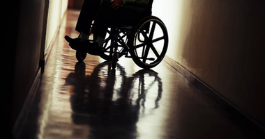 Wheelchair in hospital hallway