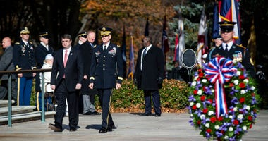 Secretary of the Department of Veterans Affairs Robert Wilkie (L) places a wreath at the Tomb of the Unknown Soldier, at Arlington National Cemetery, on November 11, 2018 in Arlington, Virginia.