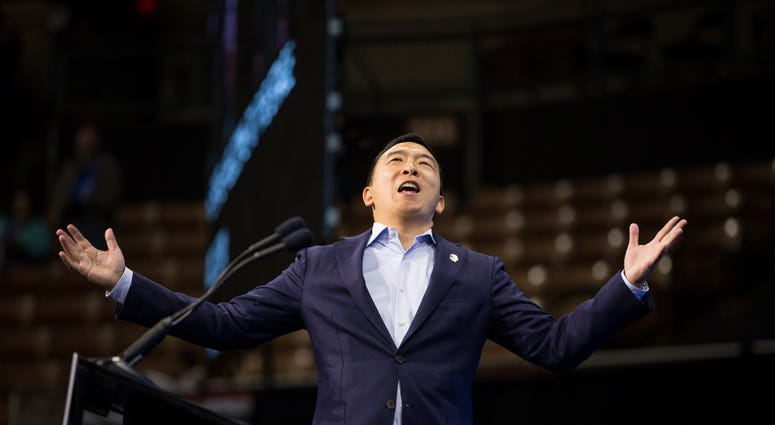 Democratic presidential candidate, entrepreneur Andrew Yang reacts as he goes on stage during the New Hampshire Democratic Party Convention