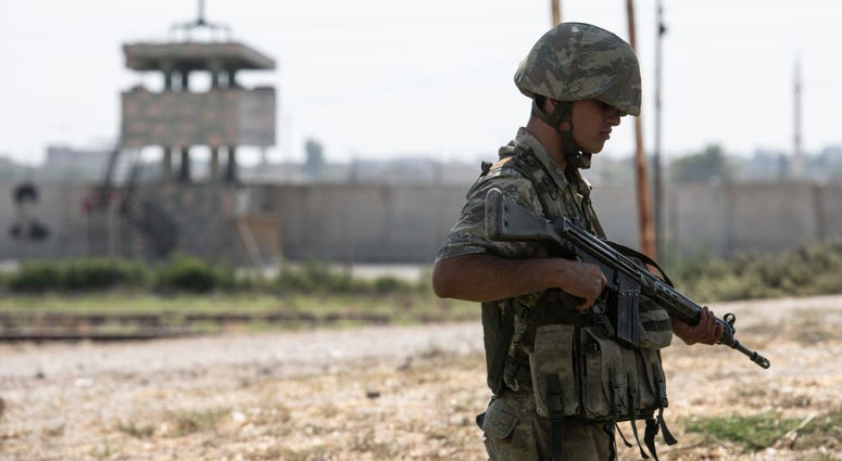 Turkish soldiers stand guard on the Turkish side of the border between Turkey and Syria on October 09, 2019 in Akcakale, Turkey.