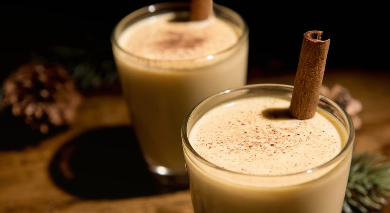 Close up of homemade traditional Christmas eggnog drinks in the glasses - stock photo