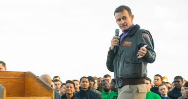 In this handout released by the U.S. Navy, Capt. Brett Crozier, commanding officer of the aircraft carrier USS Theodore Roosevelt (CVN 71), gives remarks during an all-hands call on the ships flight deck Dec. 15, 2019.