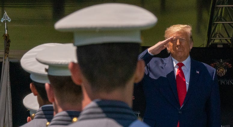 U.S. President Donald Trump salutes cadets at the beginning of the commencement ceremony on June 13, 2020 in West Point, New York.