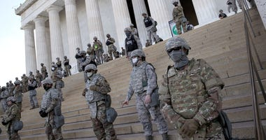 Members of the D.C. National Guard stand on the steps of the Lincoln Memorial as demonstrators participate in a peaceful protest against police brutality and the death of George Floyd, on June 2, 2020 in Washington, DC.
