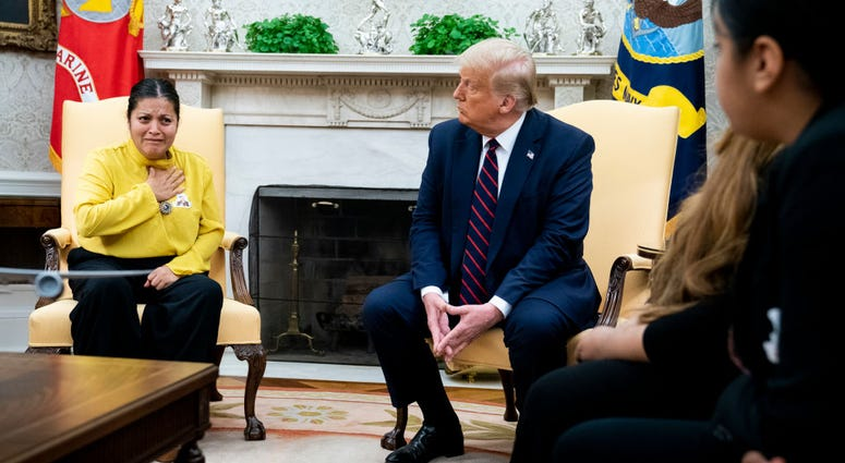 President Donald Trump meets with Gloria Guillen, mother of missing Fort Hood soldier Vanessa Guillen, in the Oval Office of the White House July 30, 2020 in Washington, DC.